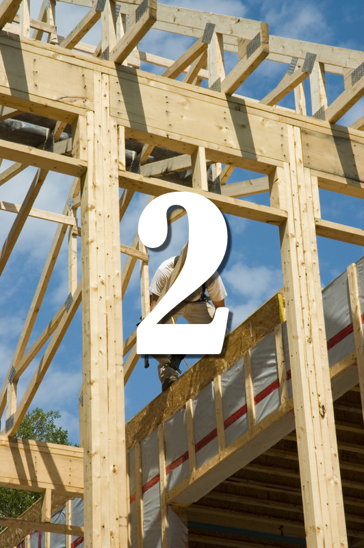 construction worker framing a house like building the framework to a WordPress website