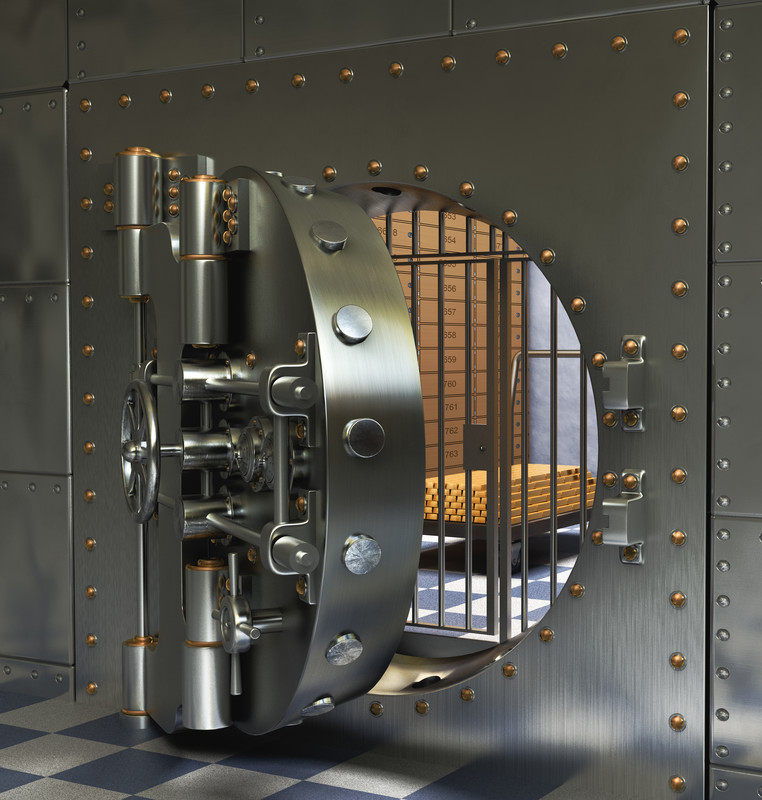 bank vault with door halfway open so you can see gold and safe deposit boxes on the inside.