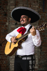 mariachi band singer with guitar