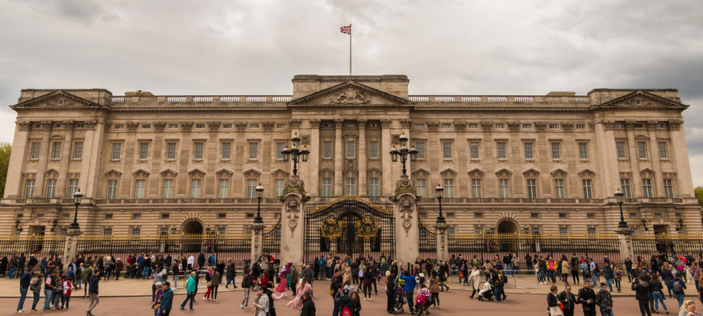 Historical British building with tourists. The UK is a popular destination, and even British people like to travel within the country, so there are many UK travel affiliate programs.