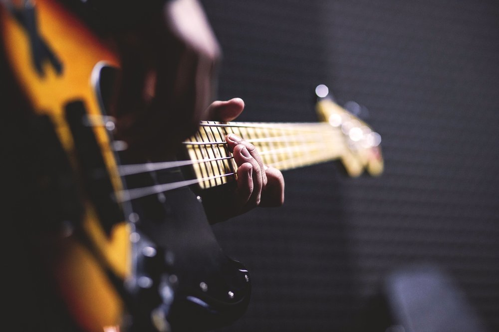 A person playing guitar to represent digital music affiliate programs