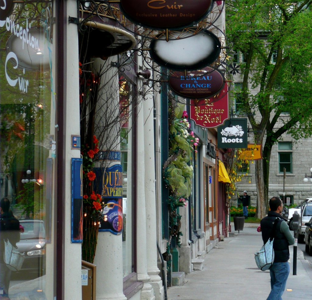 walking street with boutique stores selling clothing in Canada