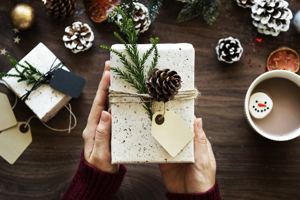 presents and pinecones to represent seasonal affiliate programs
