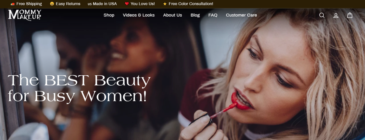 Screenshot of the Mommy Makeup homepage showing a woman applying lip gloss and displaying the brand slogan - The Best Beauty for Busy Women.