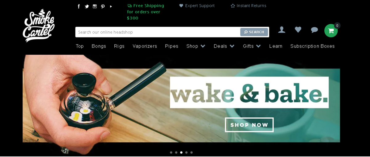 "Screenshot of the Smoke Cartel website showing a photo of a pipe alongside text reading ""wake and bake""."