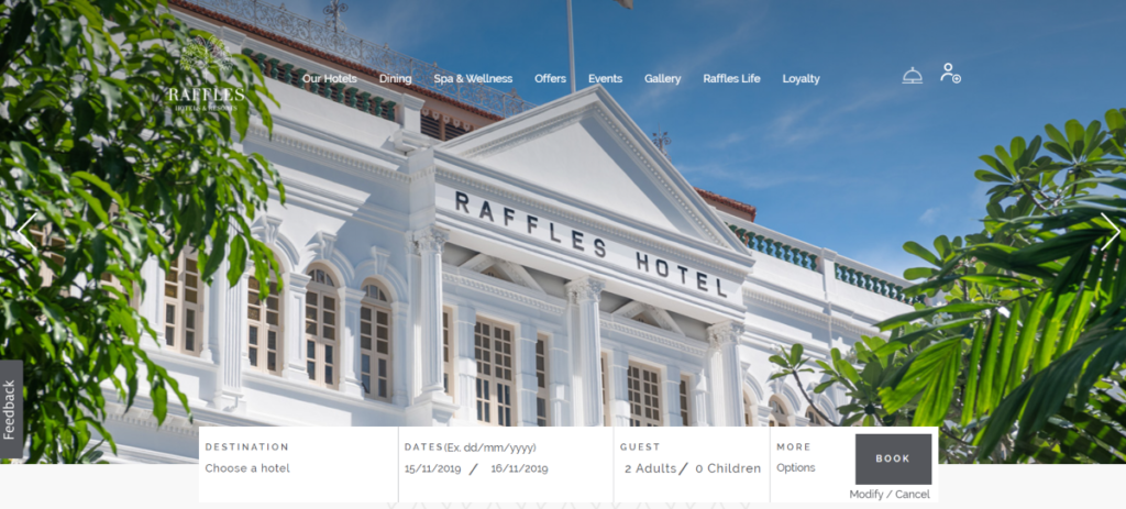 This is a screenshot of the raffles.com website showing a photo of one of their Raffles Hotels.