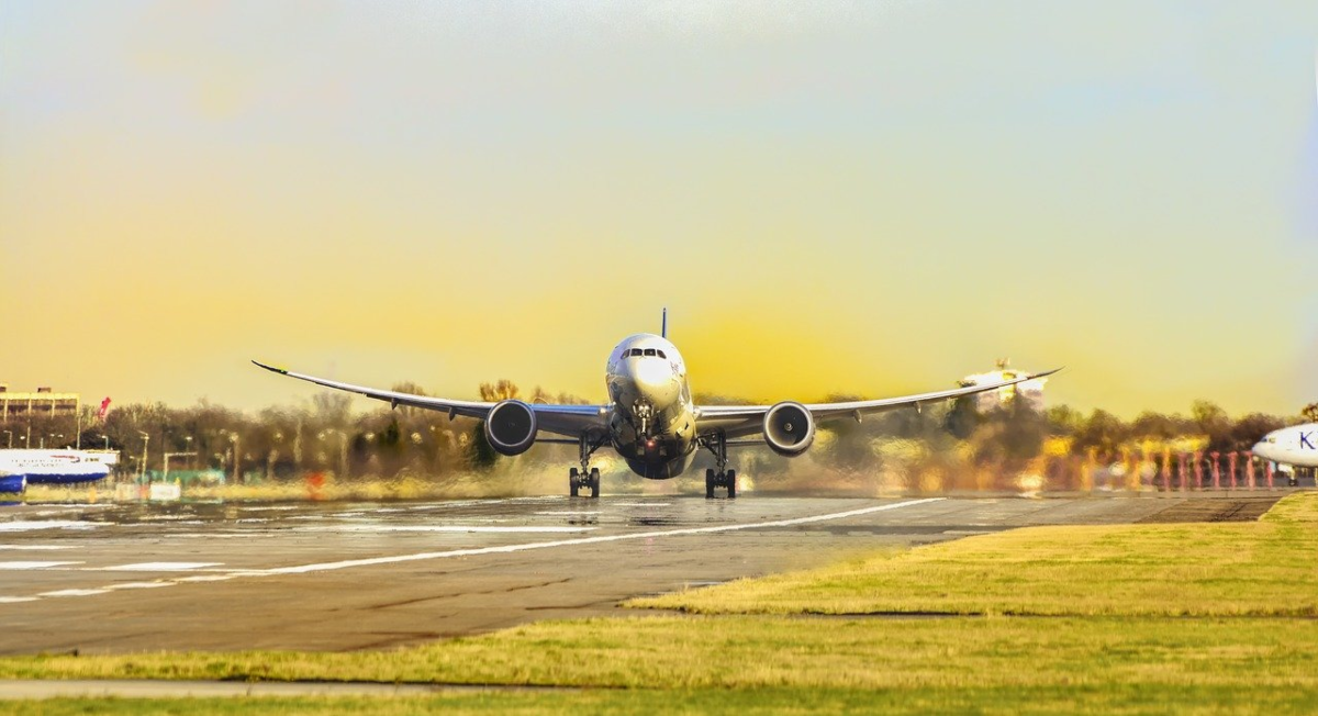This is a photo of an airplane on a runway about to takeoff.