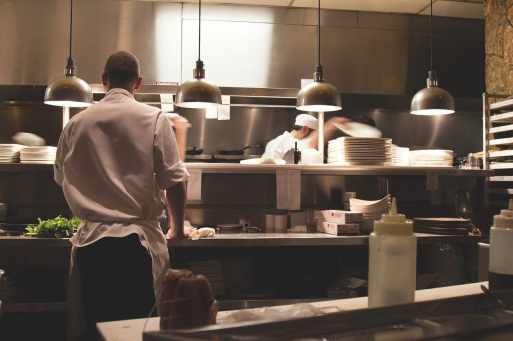 People working in a kitchen to represent cooking affiliate programs
