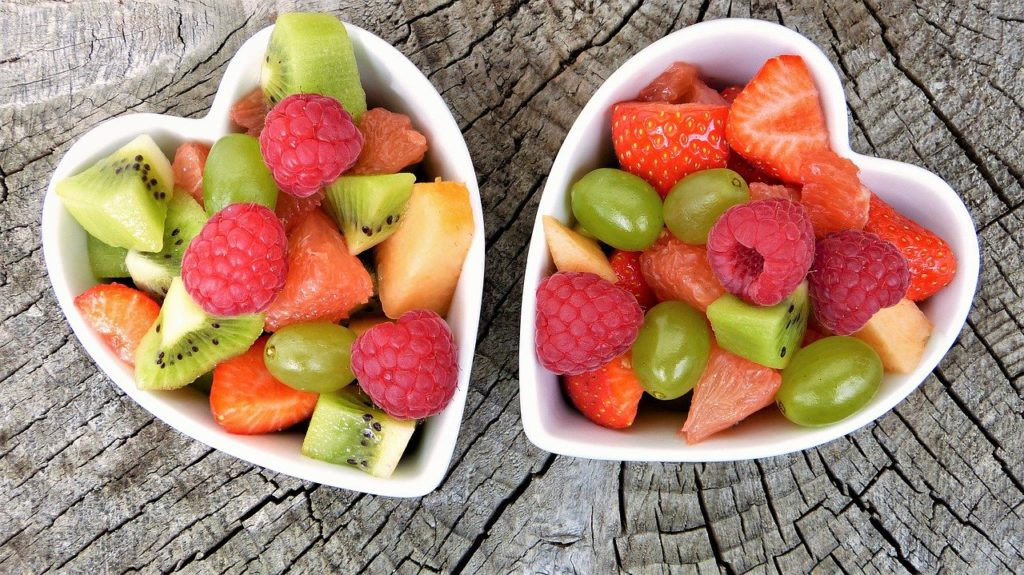 An assortment of fruit in heart shaped bowls to represent vitamin affiliate programs