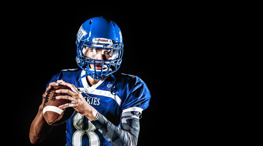 football player holding football to represent american football affiliate programs