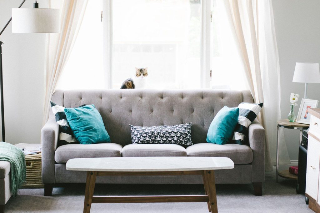 a couch and pillows to represent furniture affiliate programs