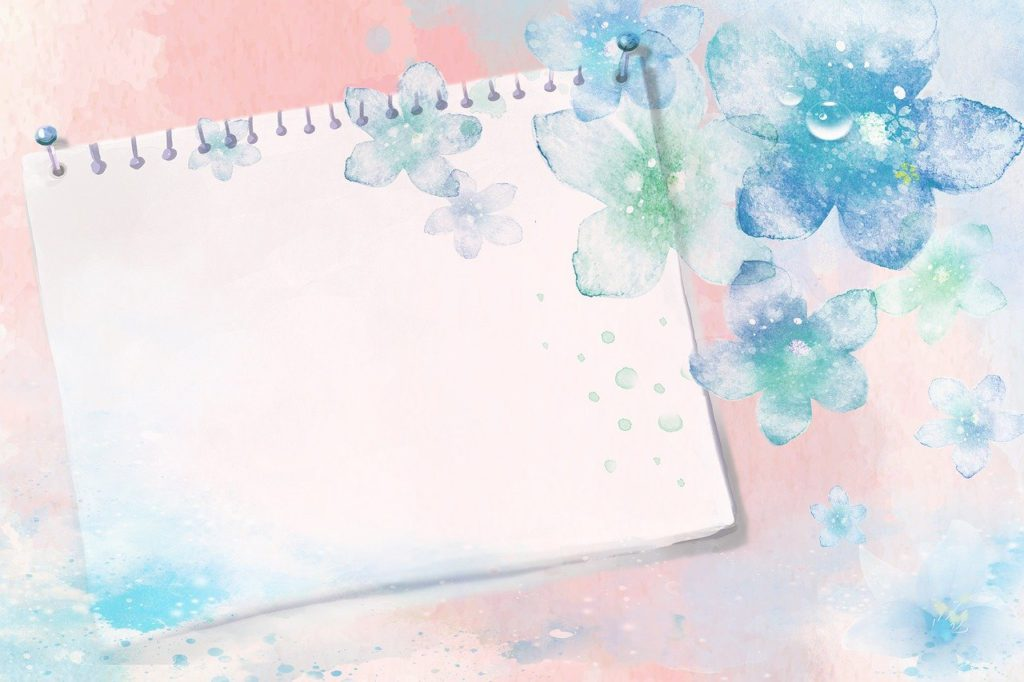 a notebook surrounded by a watercolor design to represent stationery affiliate programs