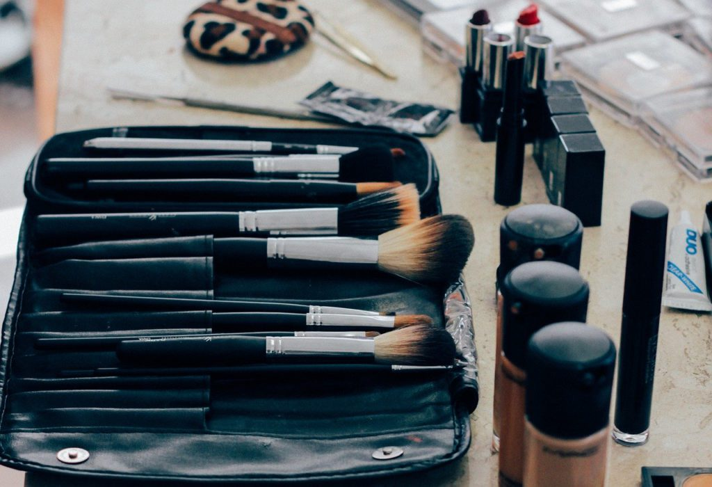 makeup products and brushes to represent korean beauty product affiliate programs