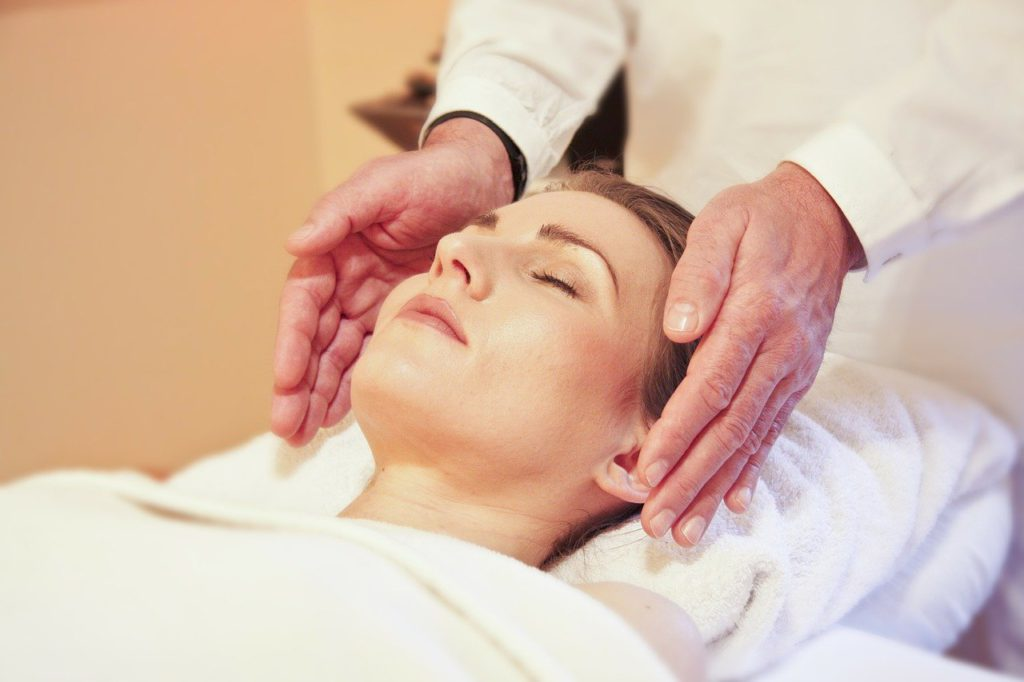 a woman getting a massage to represent reiki affiliate programs