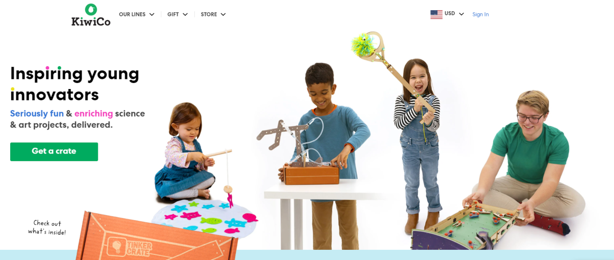 This is a screenshot taken from the kiwico.com website showing a photo of kindergarten age kids having fun with science projects.