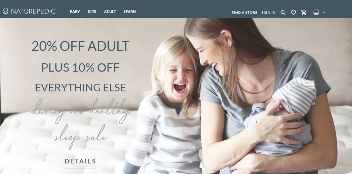 This is a screenshot of the NaturePedic.com website showing a family sitting and smiling on a mattress that's made from all-natural products making it perfect for families.