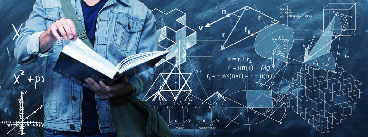 Image shows a student studying a textbook with a blackboard in the background showing various STEM (science, technology, engineering and math) equations, formulas and diagrams.
