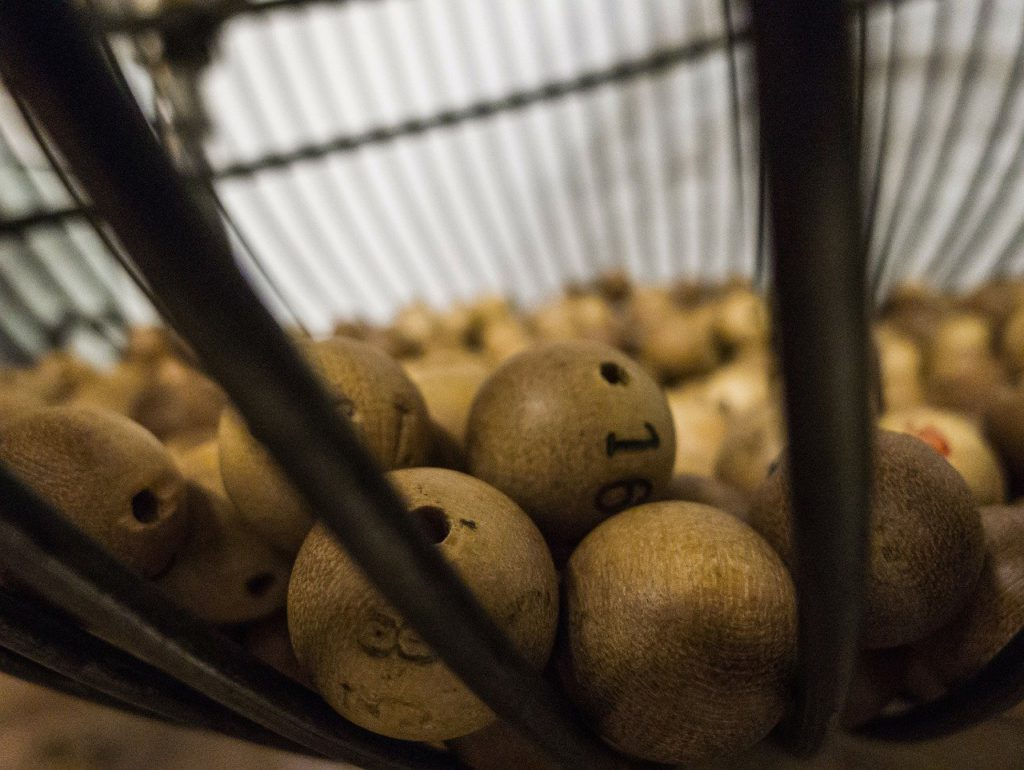 numbered balls sitting in a cage to represent lottery affiliate programs