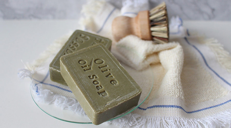 closeup image of men's grooming products, soap, brush, towels