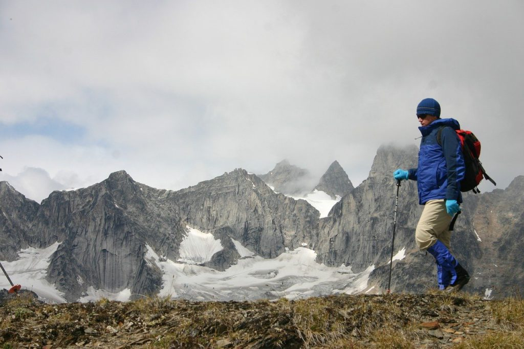 a person hiking in some mountains to represent outdoor gear affiliate programs