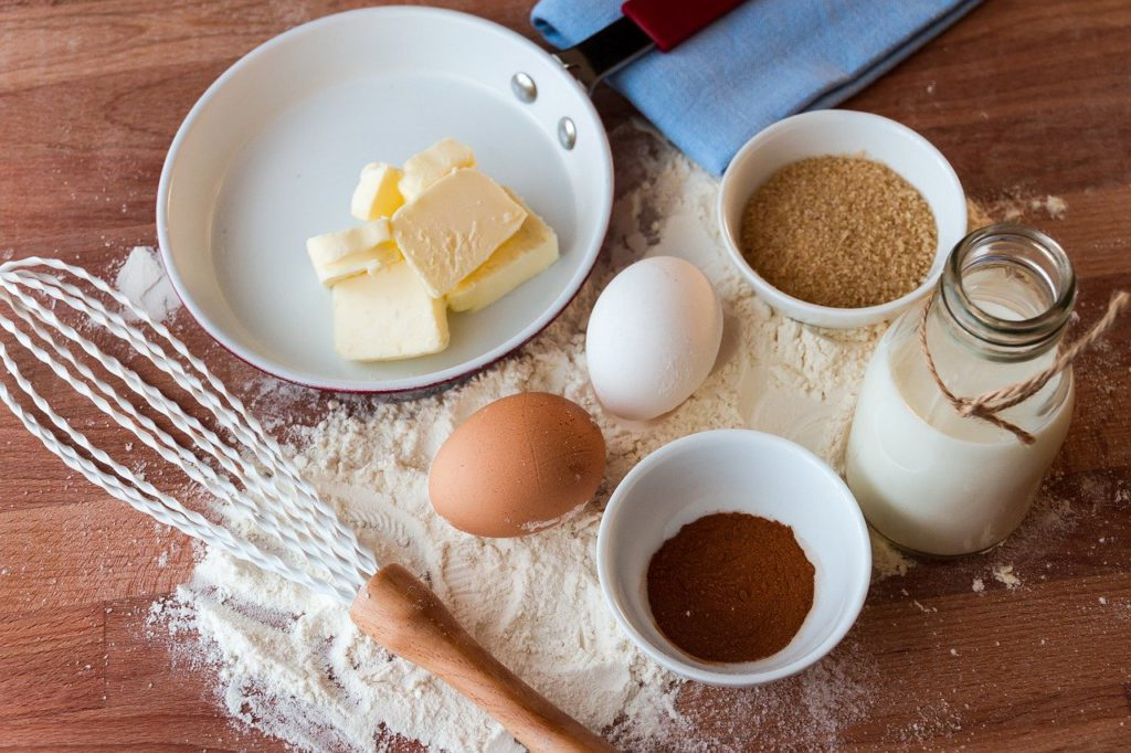 a bunch of raw ingredients and a whisk on a table to represent recipe affiliate programs