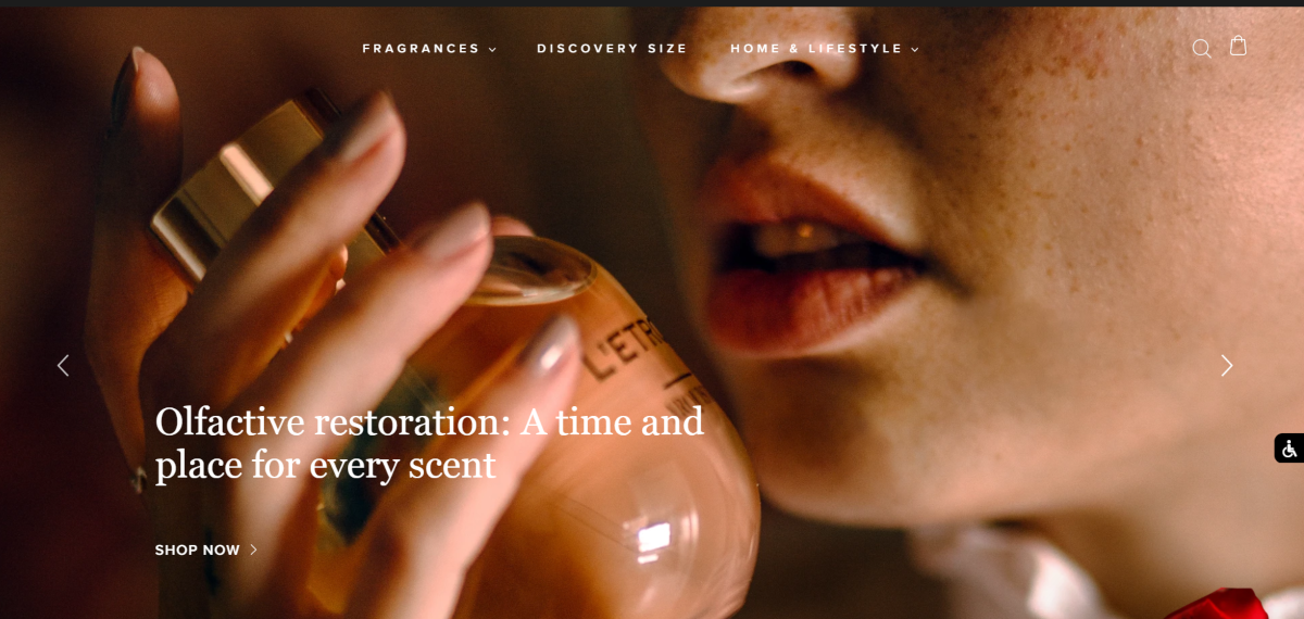 This is a screenshot taken from the arquiste.com website showing a photo of a woman holding a bottle of perfume up close with their brand slogan - a time and a place for every scent.