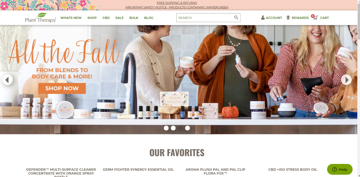 This is a screenshot taken from the PlantTherapy.com website that has an image of a group of ladies enjoying a range of aromatherapy products including the lotions and putting oil into a diffuser.