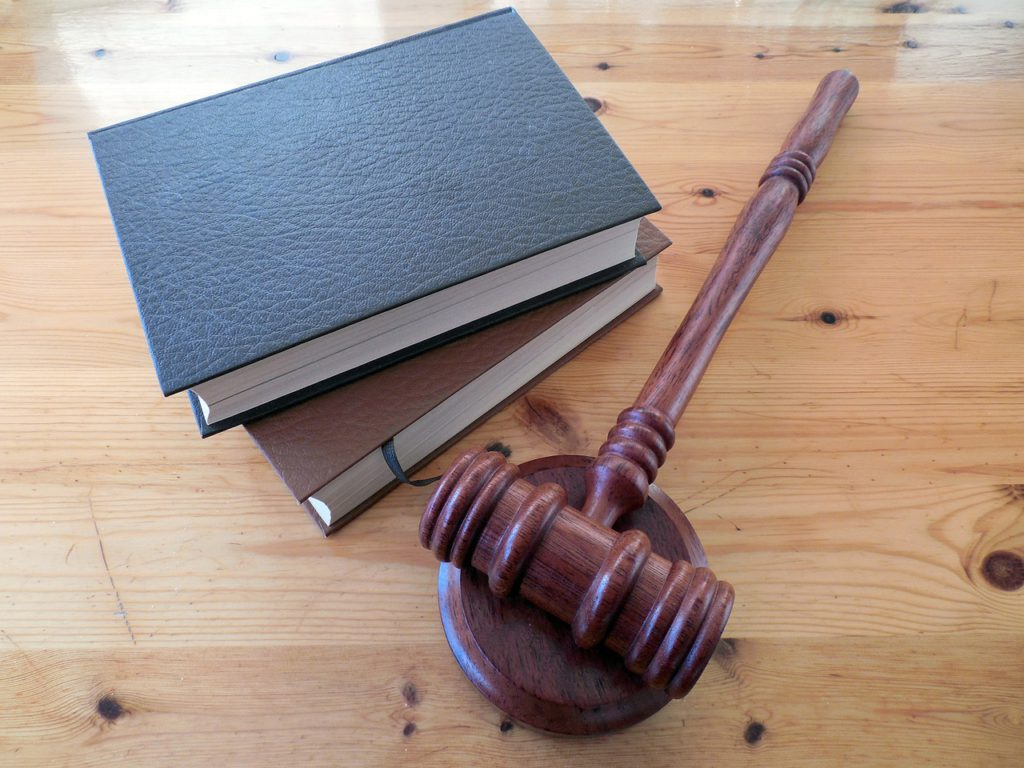 a gavel and two books on a table to represent lawyer affiliate programs