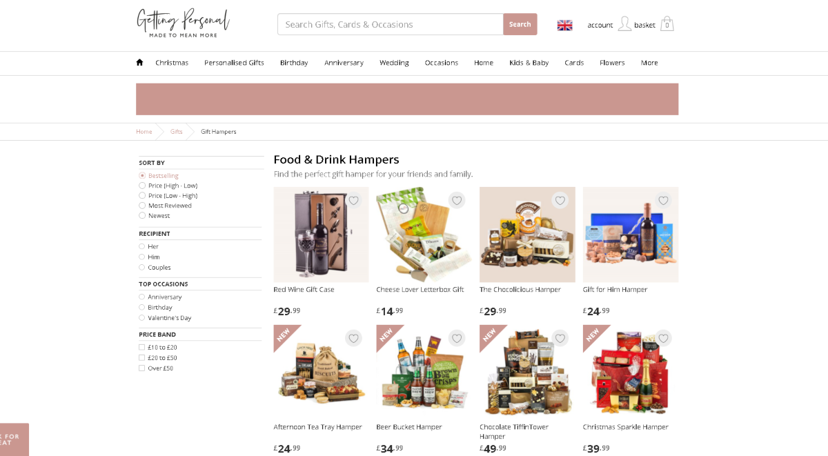 The image shows a screen capture of the food and drink hampers category on GettingPersonal.co.uk featuring some packages presented in baskets.