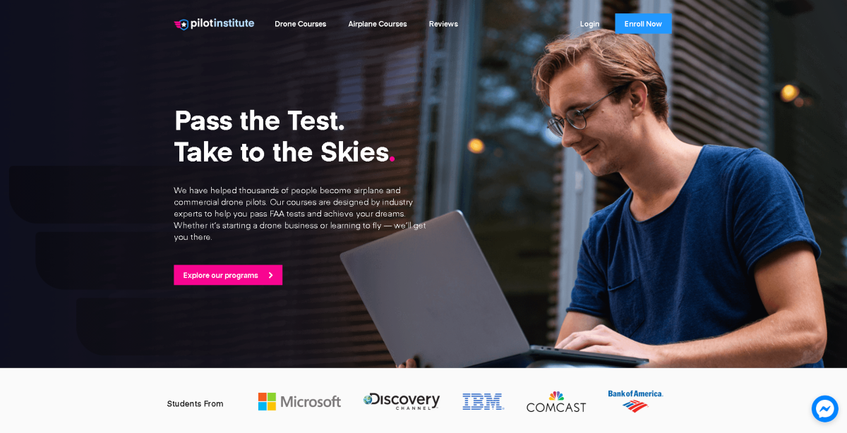 "This is a screenshot taken from pilotinstitute.com that shows a man with a laptop and a slogan that reads ""Pass the Test. Take to the Skies""."